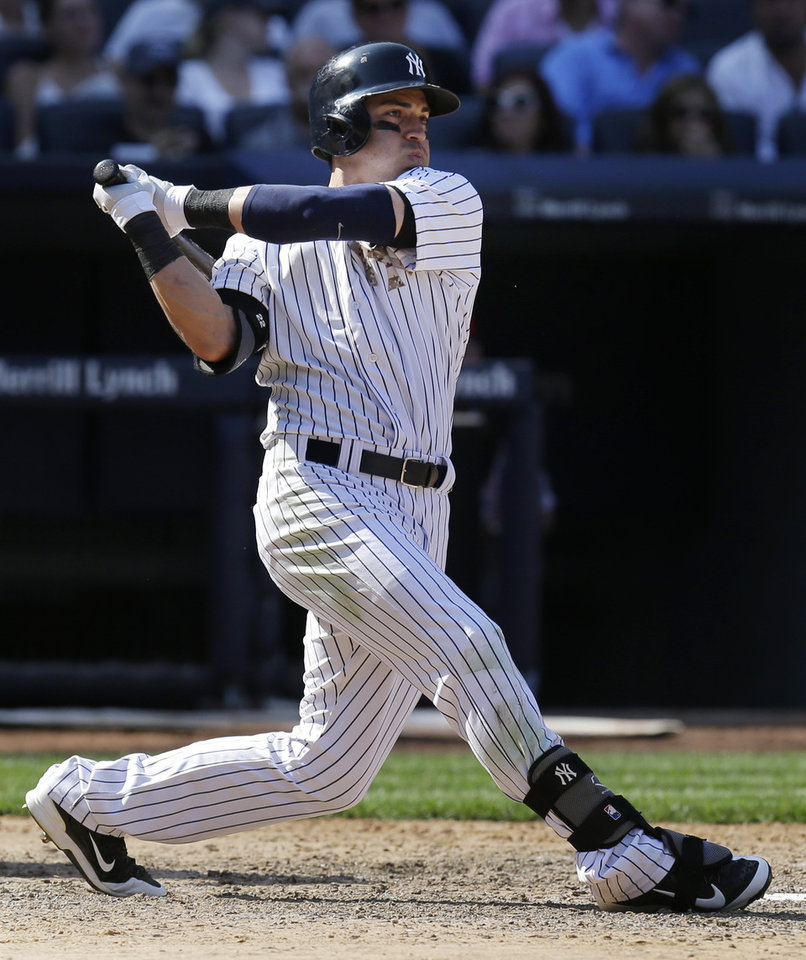 Photo - New York Yankees' Jacoby Ellsbury bats during the ninth inning of the game against the Cincinnati Reds at Yankee Stadium Sunday, July 20, 2014 in New York. The Yankees defeated the Reds 3-2. (AP Photo/Seth Wenig)