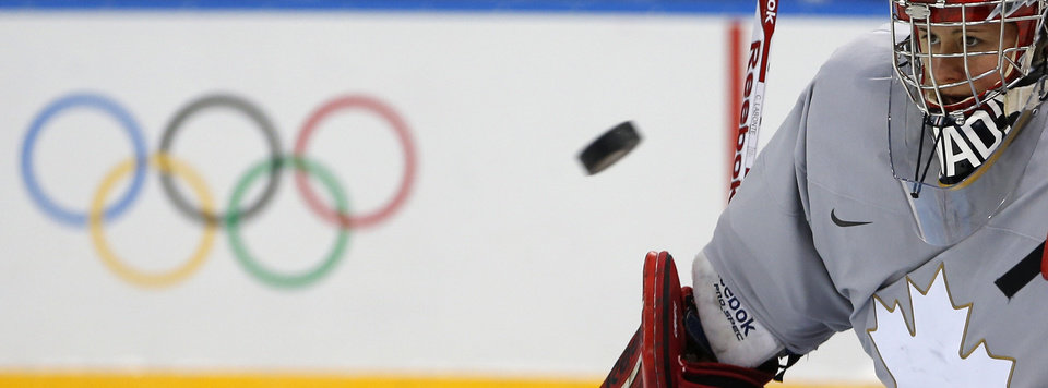 Photo - Goalkeeper of Canada's women's ice hockey team Shannon Szabados eyes a puck during a practice session ahead of the 2014 Winter Olympics, Thursday, Feb. 6, 2014, in Sochi, Russia. (AP Photo/Petr David Josek)
