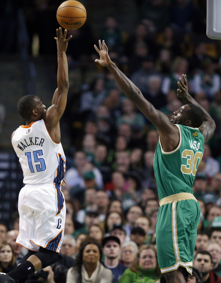 Photo - Charlotte Bobcats' Kemba Walker (15) shoots over Boston Celtics' Brandon Bass (30) in the first quarter of an NBA basketball game in Boston, Saturday, March 16, 2013. (AP Photo/Michael Dwyer)