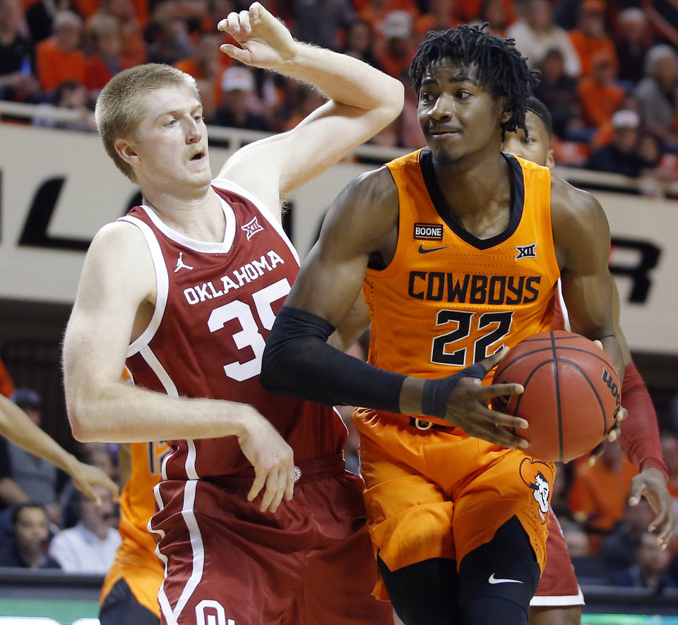 Photo - Oklahoma State's Kalib Boone (22) goes past Oklahoma's Brady Manek (35) during an NCAA men's Bedlam basketball game between the Oklahoma State University Cowboys (OSU) and the University of Oklahoma Sooners (OU) at Gallagher-Iba Arena in Stillwater, Okla., Saturday, Feb. 22, 2020. Oklahoma State won 83-66. [Bryan Terry/The Oklahoman]