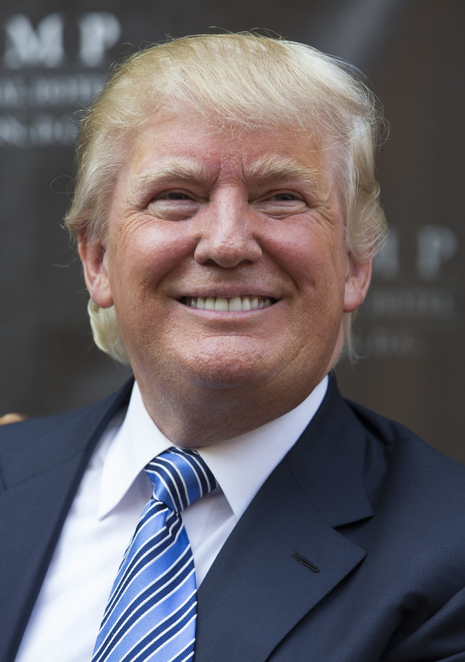 Photo - Donald Trump smiles during a ground breaking ceremony for the Trump International Hotel on the site of the Old Post Office, on Wednesday, July 23, 2014, in Washington. (AP Photo)
