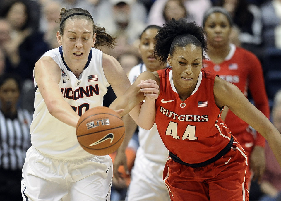 Photo - Connecticut's Breanna Stewart, left, steals the ball from Rutgers' Betnijah Laney, right, during the first half an NCAA college basketball game, Saturday, March 1, 2014, in Storrs, Conn. (AP Photo/Jessica Hill)