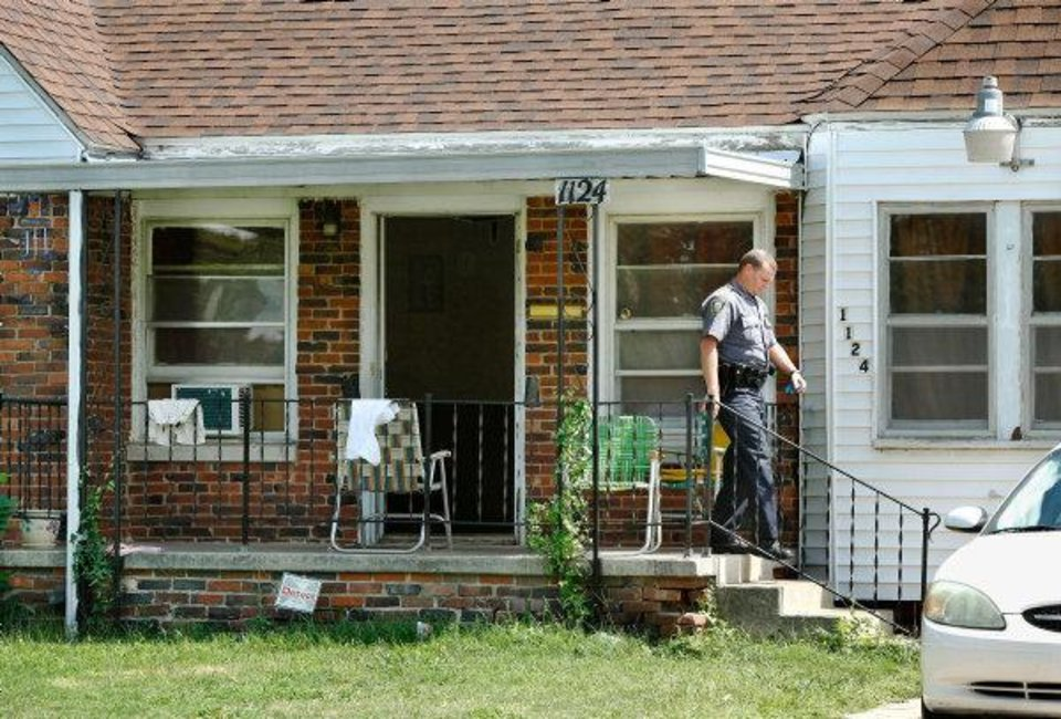 HOUSE EXTERIOR / ARREST: A police officer leaves this home at 1124 SW 36 where police say a woman was arrested for  forcing a 5-year-old girl  to live in a closet among her own urine and feces. Police said Asusena Marie Gonzales, 31, was arrested Monday on a complaint of child neglect. Photo by Jim Beckel, The Oklahoman.  ORG XMIT: KOD
