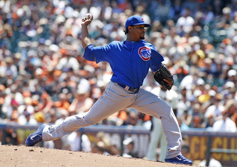 Photo - Chicago Cubs pitcher Edwin Jackson throws to the San Francisco Giants during the first inning of a baseball game, Wednesday, May 28, 2014, in San Francisco. (AP Photo/George Nikitin)