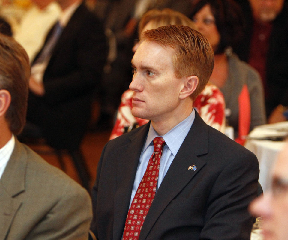 Photo - U.S. Rep. James Lankford, R-Oklahoma City, listens to guest speaker Wes Lane during the Mayor's Prayer Breakfast in Edmond on Tuesday. Photo by Paul Hellstern, The Oklahoman  PAUL HELLSTERN - Oklahoman
