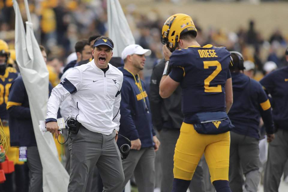Photo - West Virginia head coach Neal Brown yells at the official during a timeout during their NCAA college football game against Oklahoma State in Morgantown, W.Va., on Saturday, Nov. 23, 2019. (AP Photo/Chris Jackson)