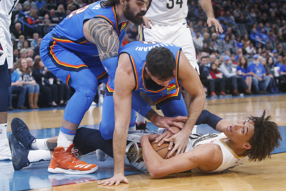 Photo - Oklahoma City Thunder center Steven Adams, left, and forward Danilo Gallinari, center, and New Orleans Pelicans center Jaxson Hayes, right, scramble for the ball during the first half of an NBA basketball game Friday, Nov. 29, 2019, in Oklahoma City. [AP Photo/Sue Ogrocki]