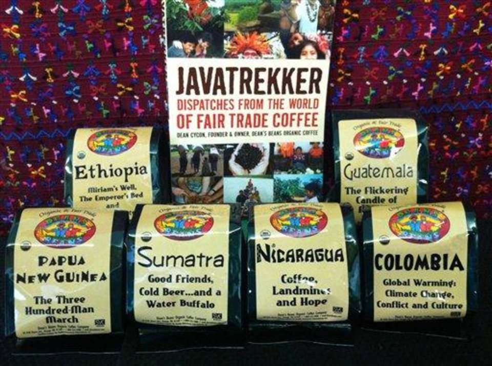 "In this undated publicity photo provided by Dean's Beans Organic Coffee, the ""Javatrekker: Dispatches from the World of Fair Trade Coffee,"" written by founder Dean Cycon and sampler coffees from Papua New Guinea, Ethiopia, Sumatra, Nicaragua, Guatemala and Colombia are shown. (AP Photo/Dean's Beans Organic Coffee, Dean Cycon)"