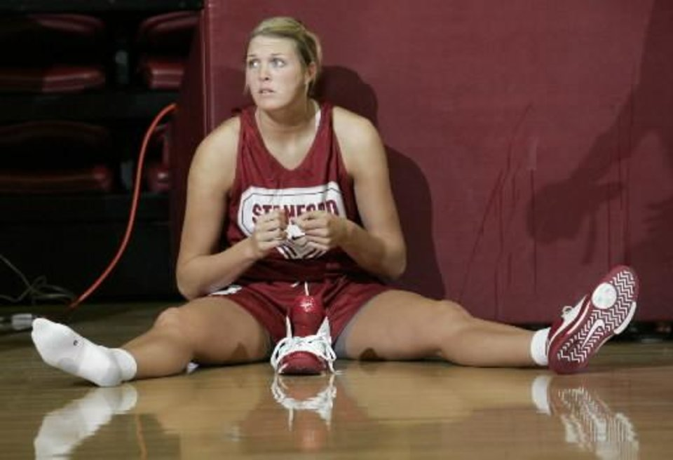 Photo - Stanford center  Jayne  Appel puts on her shoes during an NCAA college basketball practice in Stanford, Calif., Wednesday, March 31, 2010. Stanford play Oklahoma in the semifinals of the Final Four on Sunday. (AP Photo/Paul Sakuma)