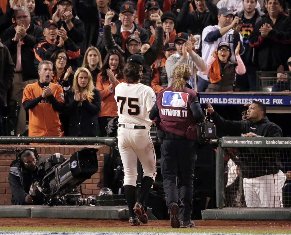 Photo -   San Francisco Giants' Barry Zito leaves the game after pitching into the sixth inning of Game 1 of baseball's World Series against the Detroit Tigers, Wednesday, Oct. 24, 2012, in San Francisco. (AP Photo/Charlie Riedel)