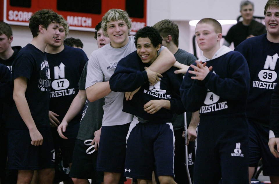 The Edmond North Huskies react as defeat the Muskogee Roughers at the class 5A and 6A Dual State wrestling finals at Claremore high school in Claremore, Okla., taken on February 9,2013. JAMES GIBBARD/Tulsa World