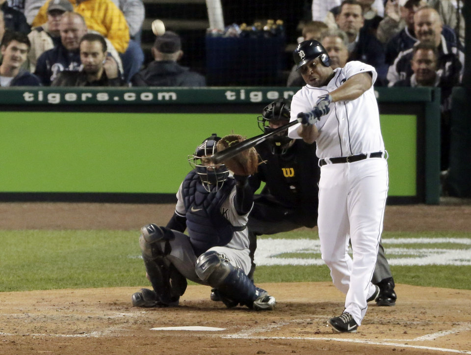 Photo -   Detroit Tigers' Delmon Young hits a home run in the fourth inning during Game 3 of the American League championship series against the New York Yankees Tuesday, Oct. 16, 2012, in Detroit. (AP Photo/Charlie Riedel)