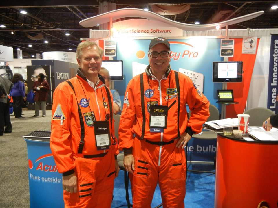 Jerry Carter, left,  and Dan Bintz, business partners in Acuity Pro vision-science software, pose wearing NASA jumpsuits at a recent optometry meeting trade show in Atlanta. PHOTO PROVIDED <strong></strong>