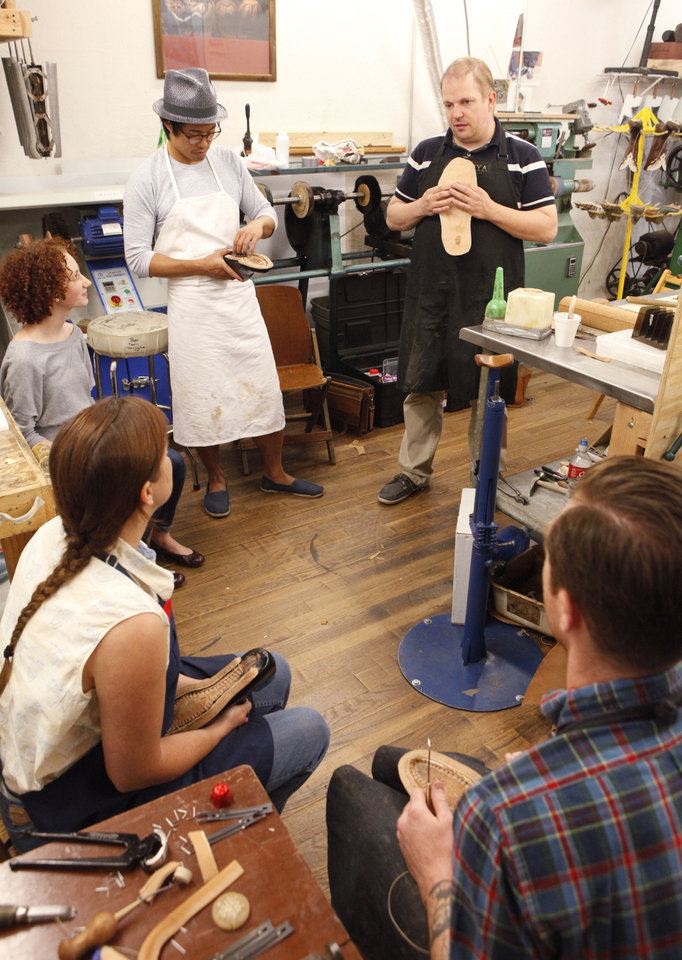 Photo - Hungarian shoemaker Marcell Mrsán, top right, is visiting Sorrell Custom Boots in Guthrie this week to teach students his trade, Thursday, July 19 , 2012. Photo By David McDaniel/The Oklahoman  David McDaniel - The Oklahoman