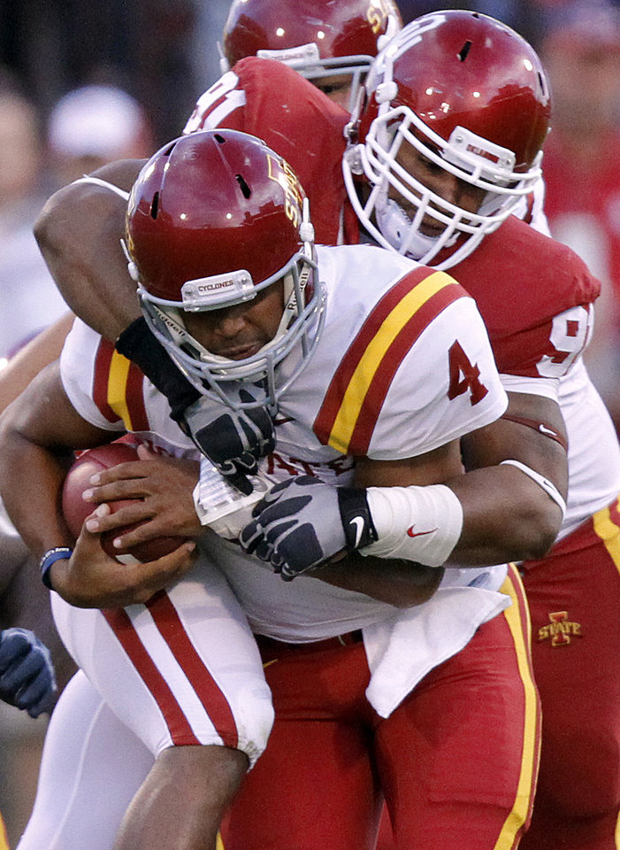 Photo - Oklahoma's R.J. Washington (91) brings down Iowa State's Austen Arnaud (4) during the first half of the college football game between the University of Oklahoma Sooners (OU) and the Iowa State Cyclones (ISU) at the Glaylord Family-Oklahoma Memorial Stadium on Saturday, Oct. 16, 2010, in Norman, Okla.  Photo by Chris Landsberger, The Oklahoman