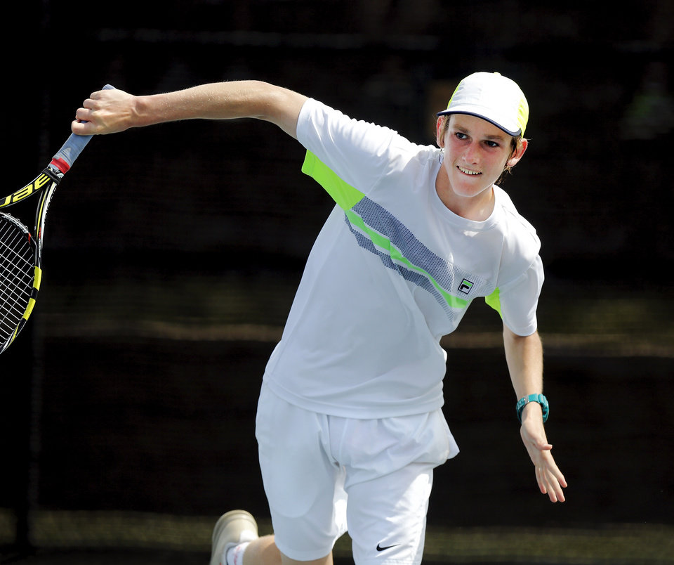 Photo - Connor Finerty of Muskogee High School battles Edmond North player David Hager in the Class 6A boys number one singles championship match during state championship tennis tournaments at the OKC Tennis Center on N. Portland Saturday afternoon, May 17, 2014. Photo by Jim Beckel, The Oklahoman