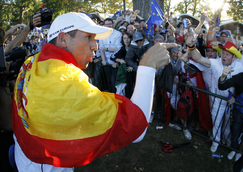Europe's Sergio Garcia celebrates after winning the Ryder Cup PGA golf tournament Sunday, Sept. 30, 2012, at the Medinah Country Club in Medinah, Ill. (AP Photo/Charles Rex Arbogast)  ORG XMIT: PGA214