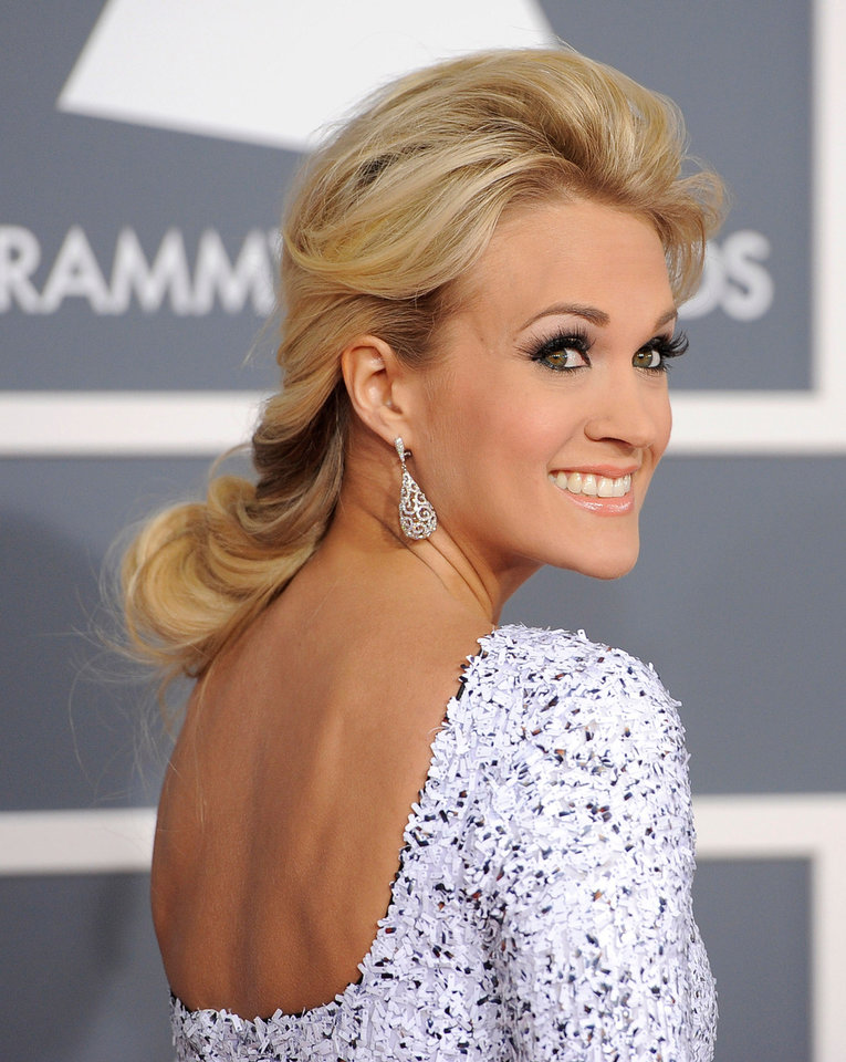 Photo - Carrie Underwood arrives at the 54th annual Grammy Awards on Sunday, Feb. 12, 2012 in Los Angeles. (AP Photo/Chris Pizzello)