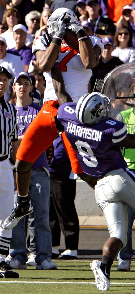 Photo - Oklahoma State's Michael Harrison (7) makes a touchdown catch over Kansas State's Stephen Harrison (8) during the first half of the college football game between the Oklahoma State University Cowboys (OSU) and the Kansas State University Wildcats (KSU) on Saturday, Oct. 30, 2010, in Manhattan, Kan.   Photo by Chris Landsberger, The Oklahoman