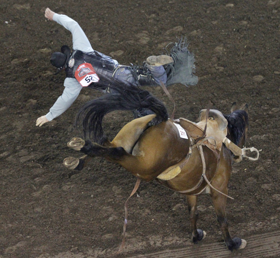 Ryan Elshere, of Elm Springs, S.D., competes in saddle bronch riding during the Ram National Circuit Finals Rodeo Championship in Oklahoma City, Sunday, April 1, 2012.  Photo by Garett Fisbeck, For The Oklahoman
