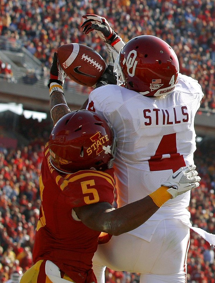 Photo - Oklahoma's Kenny Stills (4) catches a touchdown pass beside Iowa State's Jeremy Reeves (5) during a college football game between the University of Oklahoma (OU) and Iowa State University (ISU) at Jack Trice Stadium in Ames, Iowa, Saturday, Nov. 3, 2012. Photo by Bryan Terry, The Oklahoman