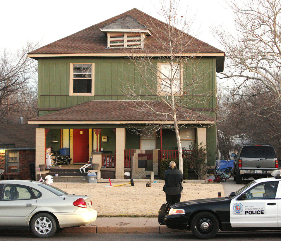 Top and above: Oklahoma City police officers investigate a shooting scene Friday  in the 1500 block of NW 39. Photos by Paul B. Southerland, The Oklahoman