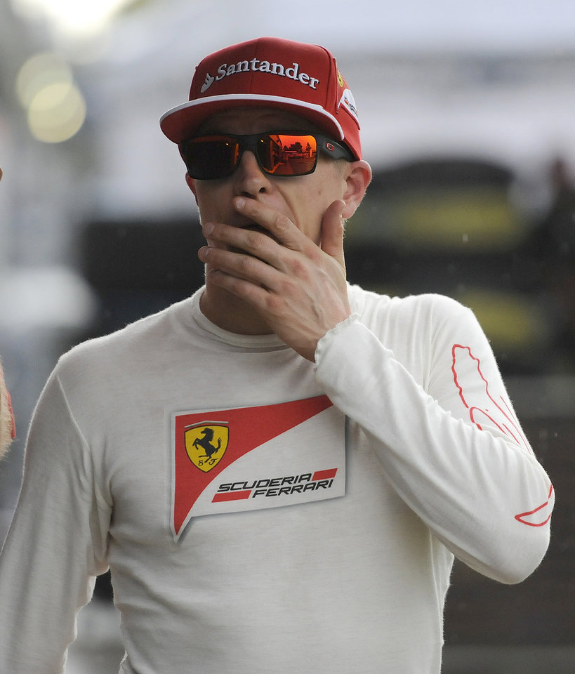 Photo - Ferrari driver Kimi Raikkonen of Finland leaves the FIA office after an on track incident with Red Bull driver Sebastian Vettel of Germany  during qualifying at Albert Park ahead of the Australian Formula One Grand Prix in Melbourne, Australia, Saturday, March 15, 2014. (AP Photo/Ross Land)