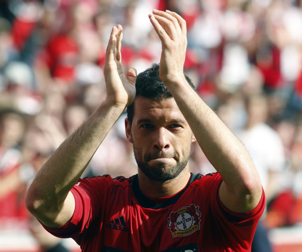 Photo -   FILE - In this April 28, 2012 file photo Leverkusen's Michael Ballack says goodbye to his fans after the German first division Bundesliga soccer match Bayer 04 Leverkusen versus Hannover 96 in Leverkusen, Germany. 36 year-old former captain of the German national soccer team Ballack announced on Tuesday, Oct. 2, 2012 that he will end his active career. (AP Photo/dapd, Roberto Pfeil, File)