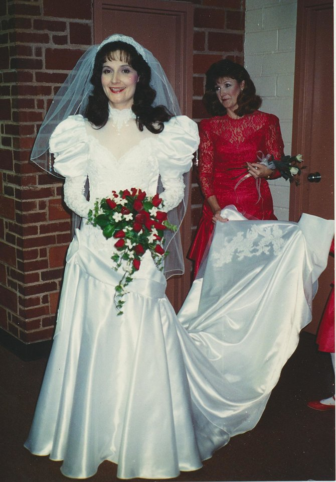 Photo - Susan Moran Crowder in her wedding gown on Dec. 3, 1988. Crowder's dress fit in with the 1980s trend of poofy shoulders that slowly tapered down. Photo provided by Susan Crowder.