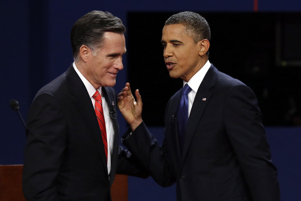 Republican presidential nominee Mitt Romney and President Barack Obama talks after the first presidential debate at the University of Denver, Wednesday, Oct. 3, 2012, in Denver. (AP Photo/Charlie Neibergall)