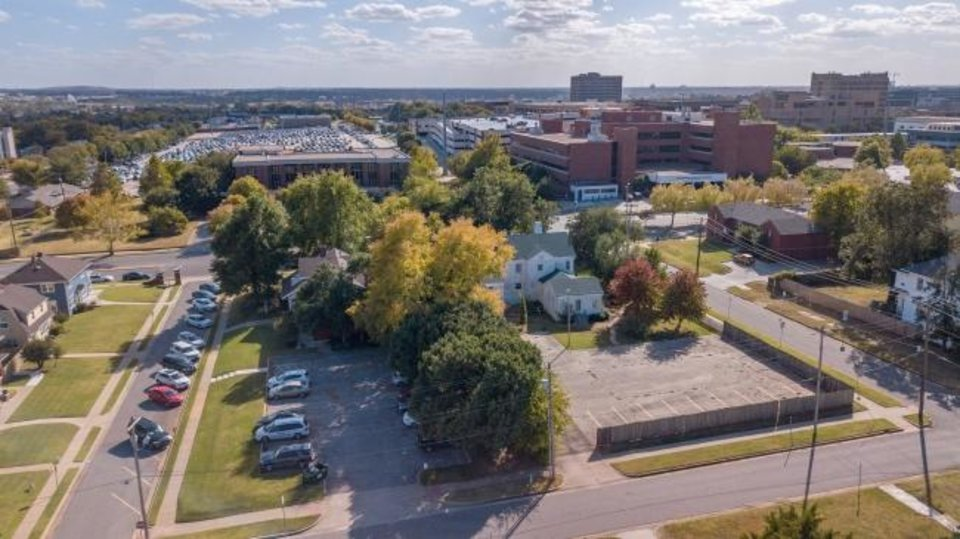 Photo -  The former Brockway Center, shown to the right, is set to be sold by The CARE Center to the Oklahoma City Redevelopment Authority while its parking lot will stay with The CARE Center, which is to the left of Brockway. The CARE Center will then be allowed to expand into it's current parking lot. [Dave Morris/The Oklahoman]