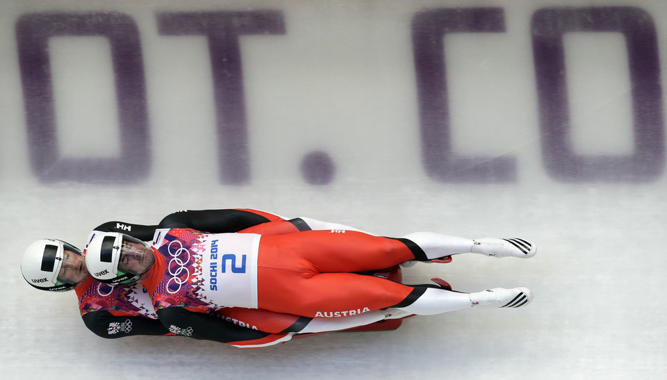 Photo - The doubles team of Andreas Linger and Wolfgang Linger from Austria speeds down the track in their first run during the men's doubles luge at the 2014 Winter Olympics, Wednesday, Feb. 12, 2014, in Krasnaya Polyana, Russia. (AP Photo/Michael Sohn)
