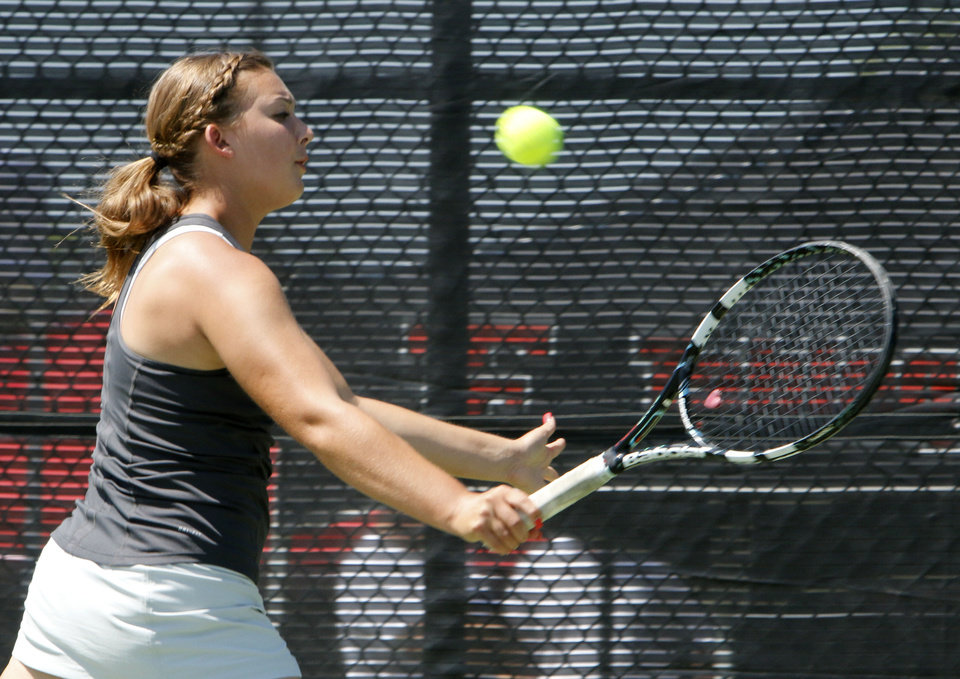 Photo - Southmoore's Jordan Henry plays her 6A final match against Bishop Kelly's Madison Westby during the Girl's State Tennis Tournament at the OKC Tennis Center in Oklahoma City, OK, Saturday, May 10, 2014,  Photo by Paul Hellstern, The Oklahoman