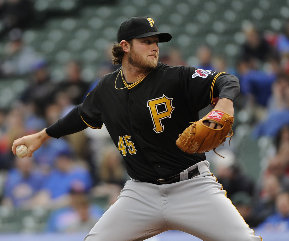 Photo - Pittsburgh Pirates starting pitcher Gerrit Cole (45) pitches against the Chicago Cubs during the first inning of a baseball game, Thursday, April 10, 2014 in Chicago.  (AP Photo/David Banks)