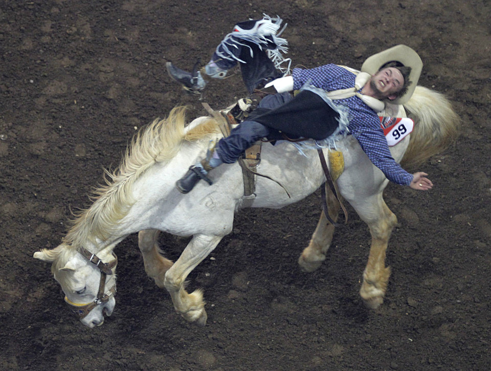 Will Lowe, of Canyon, Texas, competes in bareback riding during the Ram National Circuit Finals Rodeo Championship in Oklahoma City, Sunday, April 1, 2012.  Photo by Garett Fisbeck, For The Oklahoman