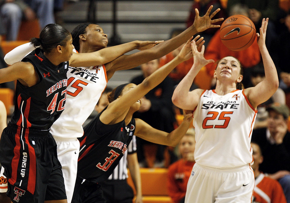 Oklahoma State's Toni Young (15) and Lindsey Keller (25) try to rebound the ball against Texas Tech's Jackie Patterson (42) and Shauntal Nobles (33) during a women's college basketball game between Oklahoma State University (OSU) and Texas Tech at Gallagher-Iba Arena in Stillwater, Okla., Wednesday, Jan. 2, 2013. Photo by Nate Billings, The Oklahoman