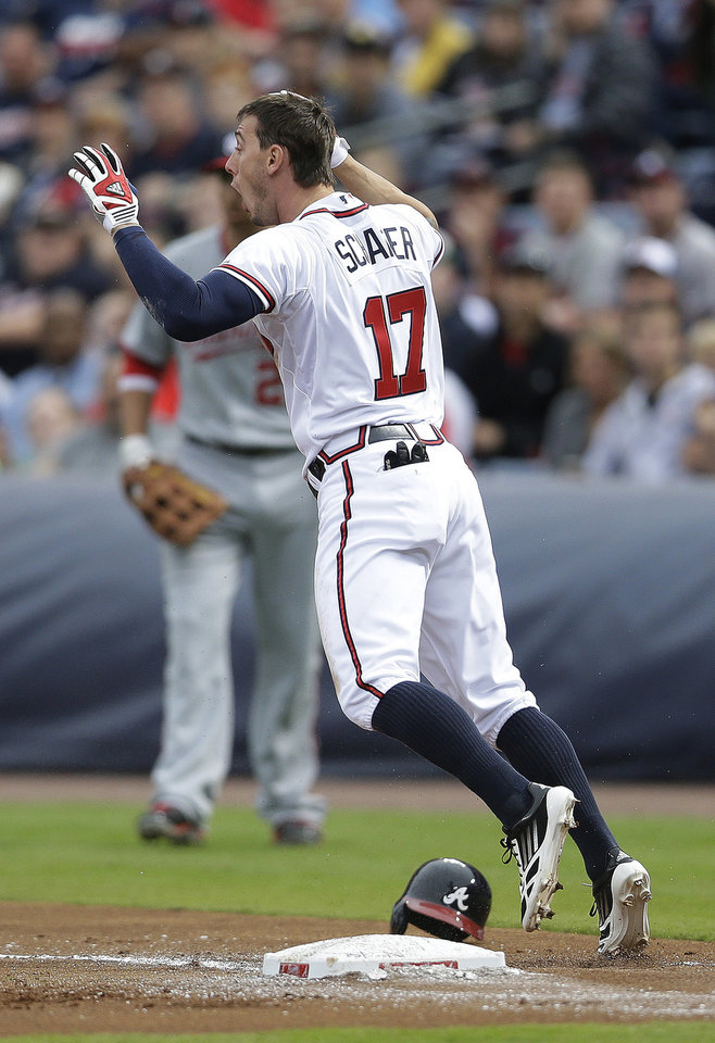 Atlanta Braves\' Jordan Schafer (17) reacts after being called out at first base on a ground ball in the first inning of a baseball game against the Washington Nationals on Wednesday, May 1, 2013, in Atlanta. (AP Photo/John Bazemore)
