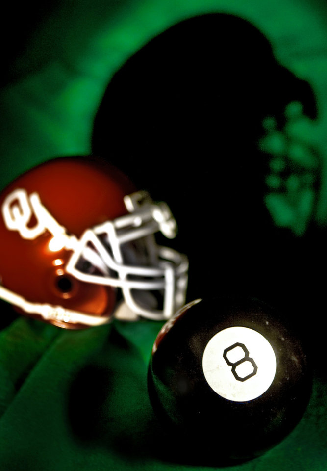 Photo - UNIVERSITY OF OKLAHOMA / COLLEGE FOOTBALL / BCS NATIONAL CHAMPIONSHIP GAME / EIGHT BALL / BOWL CHAMPIONSHIP SERIES: OU behind the 8 ball in BCS bowl game. Shot in OPUBCO studio on Friday, Jan. 2, 2009. in Oklahoma City.  Photo Illustration by CHRIS LANDSBERGER, THE OKLAHOMAN ORG XMIT: KOD