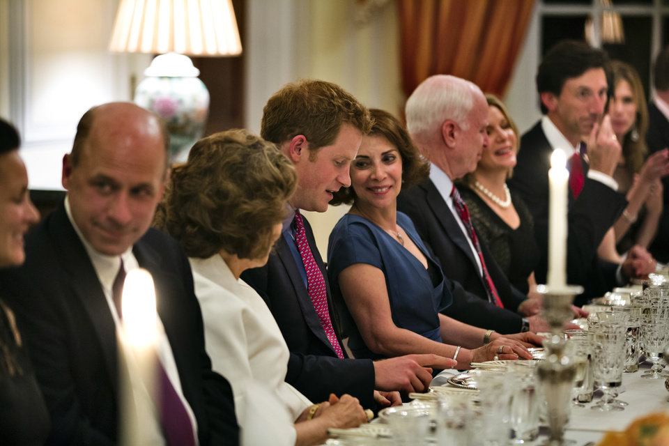 Photo - Britain's Prince Harry sits down to dinner at the Ambassador's residence in Washington, Thursday, May, 9, 2013, with Teresa Heinz, center left, wife of Secretary of State John Kerry, and the wife of the British Ambassador to the U.S. Lady Westmacott. (AP Photo/Jim Lo Scalzo, Pool)