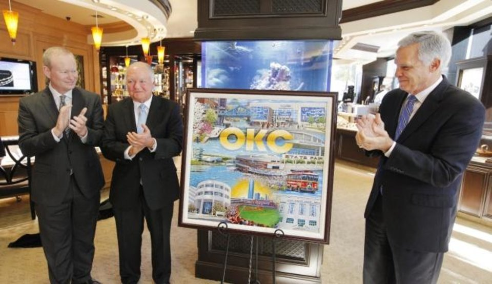 Photo -  Then-Mayor Mick Cornett applauds with former mayors Ron Norick and Kirk Humphreys during the unveiling of a rendering of the 2013 Oklahoma City Christmas ornament celebrating the MAPS program on display at B.C. Clark Jewelers in downtown Oklahoma City. [The Oklahoman Archives]