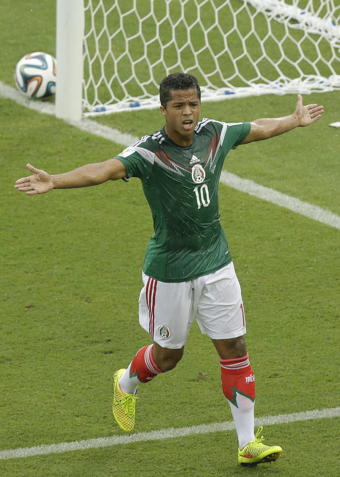 Photo - Mexico's Giovani dos Santos reacts after a goal was disallowed during the group A World Cup soccer match between Mexico and Cameroon in the Arena das Dunas in Natal, Brazil, Friday, June 13, 2014.  (AP Photo/Hassan Ammar)