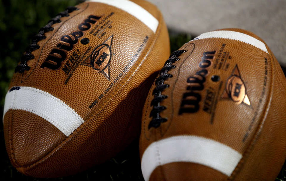 Photo - Footballs rest on the sideline during the Class 2A State semifinal football game between Millwood High School and Kingfisher High School on Saturday, Dec. 5, 2009, in Yukon, Okla. 