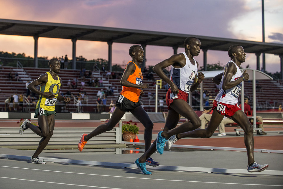 Photo -  Oklahoma State distance runner Shadrack Kipchirchir (orange jersey) is not yet an American citizen, but if everything goes according to plan, the Kenya native will one day represent the United States in the Olympics.    -  Clay Billman, OSU Athletics