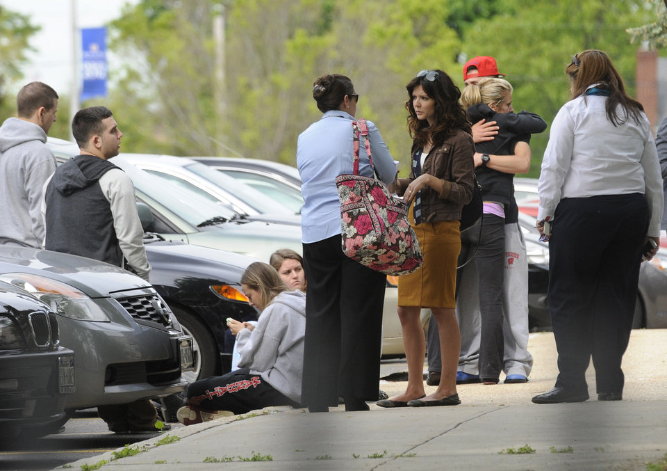 Photo - Hofstra University students gather near the house where another student and an armed intruder were killed during an overnight house break-in next to the campus, early Friday, May 17, 2013, in Uniondale, N.Y. (AP Photo/ Louis Lanzano)