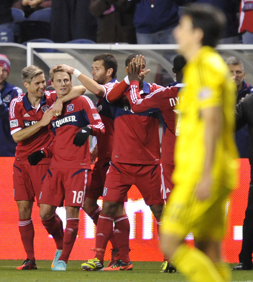 Photo -   Chicago Fire's Chris Rolfe (18), celebrates with teammates after scoring a goal during the first half of an MLS soccer match against the Columbus Crew in Bridgeview, Ill., Saturday, Sept. 22, 2012. (AP Photo/Paul Beaty)