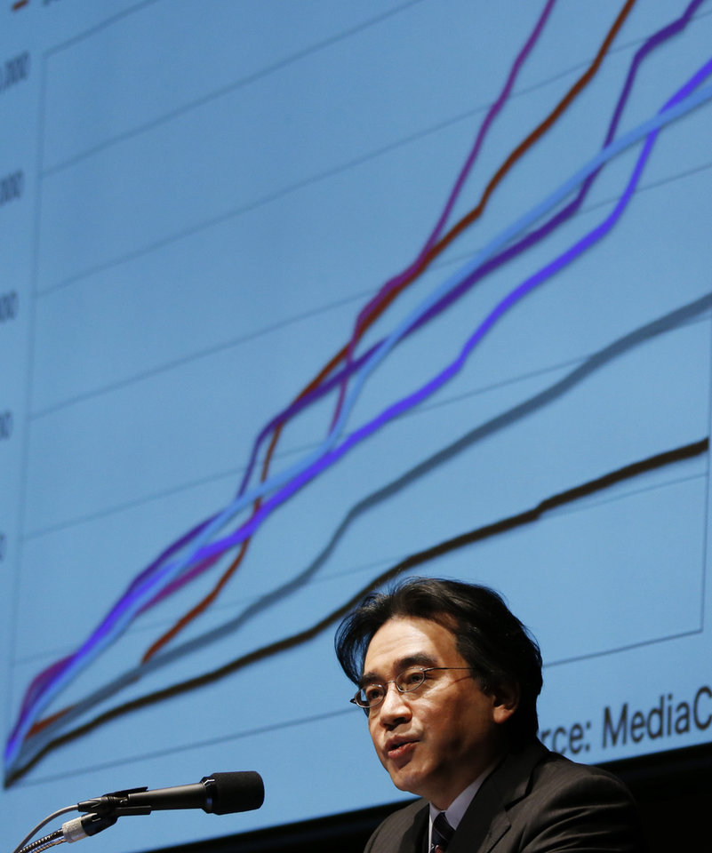 Photo - Nintendo Co. President Satoru Iwata  speaks during a news conference in Tokyo, Thursday, Jan. 31, 2013.  Iwata said the Japanese video-game maker will get back into operating profitability next fiscal year at more than 100 billion yen ($1 billion), and is ruling out price cuts for the new Wii U home console to boost sales. (AP Photo/Koji Sasahara)