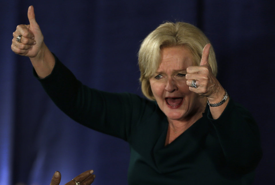 Photo -   Sen. Claire McCaskill, D-Mo., celebrates after declaring victory over challenger Rep. Todd Akin, R-Mo., in the Missouri Senate race Tuesday, Nov. 6, 2012, in St. Louis. (AP Photo/Jeff Roberson)