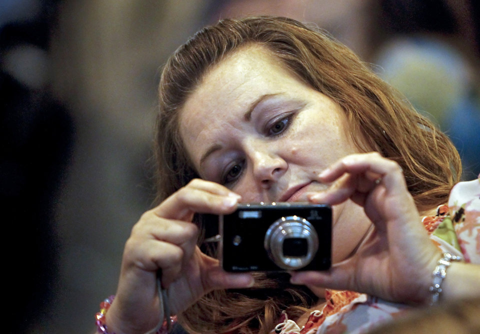 Tammy Werner takes photos as she welcomes home her sons during the return ceremony for the National Guard\'s 45th Infantry Brigade Combat Team troops at the National Guard Base on Thursday, March 15, 2012, in Oklahoma City, Oklahoma. Photo by Chris Landsberger, The Oklahoman