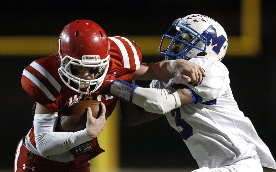 Photo - Millwood's Cameron Batson tackles Davis' Hunter Karlik during the Class 2A state football championship game between Davis and Millwood at Moore High School in Moore, Okla.,  Thursday, Dec. 19, 2013. Photo by Sarah Phipps, The Oklahoman