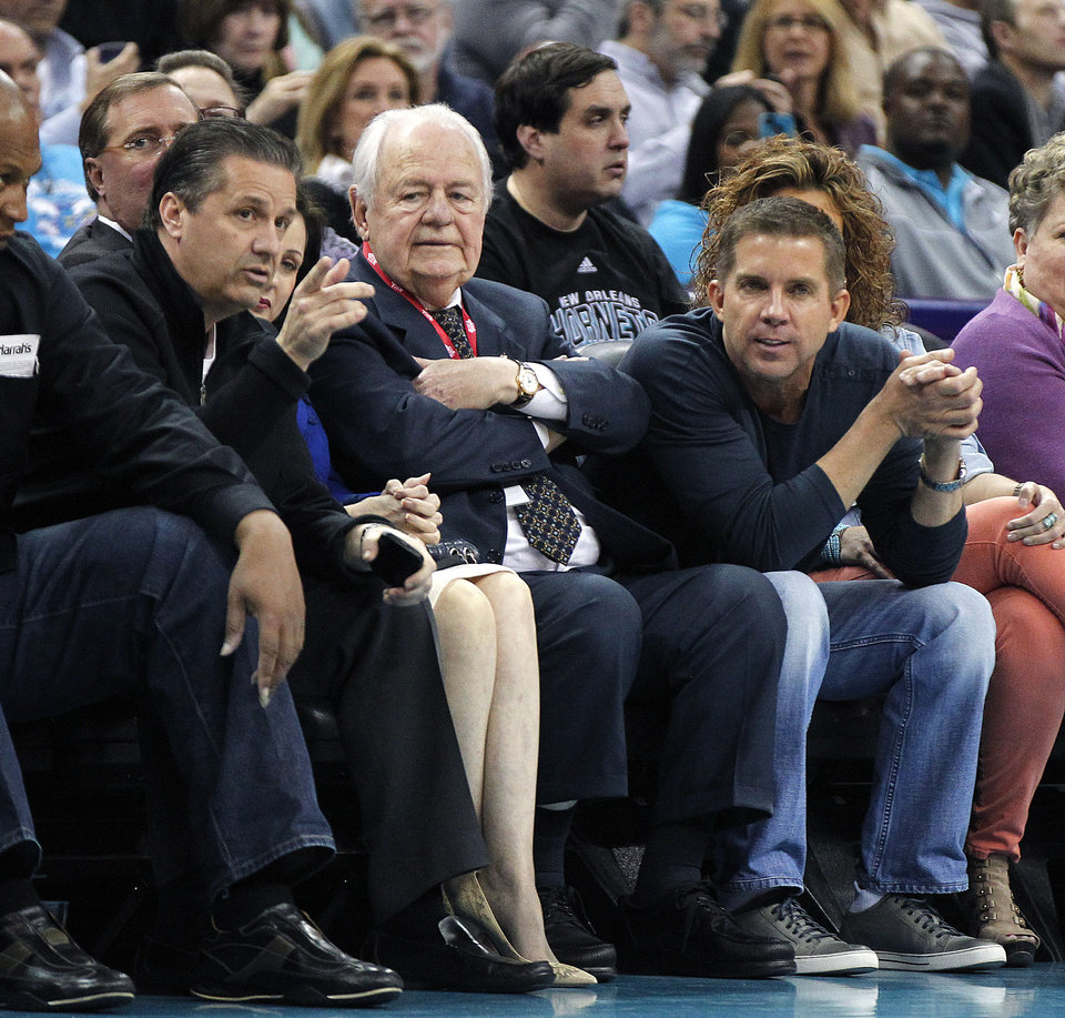 John Calipari, head NCAA college basketball coach for Kentucky, left, talks with New Orleans Hornets and NFL football New Orleans Saints owner Tom Benson, center, and Saints head coach Sean Payton in the first half of an NBA basketball game against the Los Angeles Clippers in New Orleans, Wednesday, March 27, 2013. (AP Photo/Gerald Herbert)